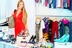 Consumerism. Fashionable girl shopping in a store Royalty Free Stock Photo