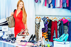 Consumerism. Fashionable girl shopping in a store Royalty Free Stock Photos