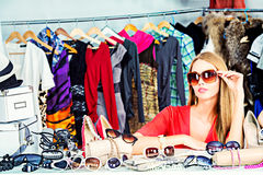 Consumerism. Fashionable girl shopping in a store Stock Images