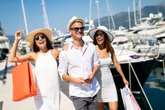 Consumerism, friends, vacation, travel concept. Beautiful people enjoying shopping having fun. Together stock image