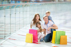 Consumerism. Happy families with a children in a store Royalty Free Stock Photo