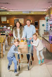 Consumerism. Happy family with a children Stock Photography