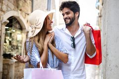 Consumerism, love, dating, travel concept. Happy couple enjoying shopping having fun. Consumerism, love, dating, travel concept. Beautiful couple enjoying stock photos