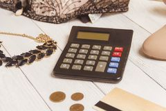 Consumerism and sale concept - calculator, women clothing, accessories. Consumerism and sale concept - calculator, women clothing, accessories Stock Image
