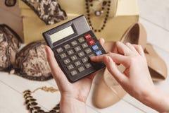 Consumerism and sale concept - calculator, women clothing, accessories. Consumerism and sale concept - calculator, women clothing, accessories Stock Photography