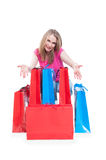 Consumerism and sale concept with cheerful woman and shopping ba Stock Images