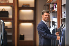 Consumerism. Smiling businessman in a store Royalty Free Stock Photography