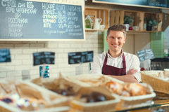 Consumerism. Smiling man in a bakery Royalty Free Stock Photos