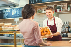 Consumerism. Smiling people in a bakery Stock Images