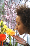 Consumerism: Woman smelling fresh flowers. Stock Photos