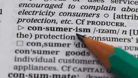 Consumerism word meaning in vocabulary, unnecessary extensive goods purchasing. Stock footage stock footage