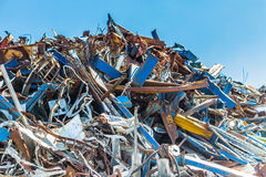 Consumerist chaos of ferrous. A chaotic collection of ferrous rusty reminds of the desolation of consumerism and the problem of waste disposal Royalty Free Stock Images