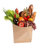 Consumers bag. Studio photography of brown grocery bag with fruits, vegetables, bread, bottled beverages - isolated over white background royalty free stock photos
