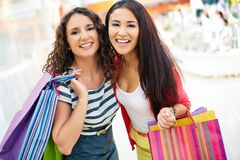 Consumers with handbags Stock Images