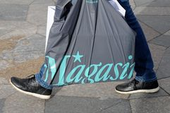 Consumers with magazin shoping bag Stock Image