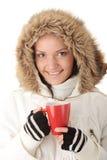 Consumición adolescente de la muchacha del invierno Fotografía de archivo libre de regalías