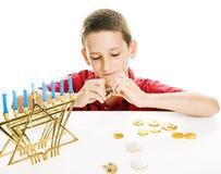 Consumición de Hanukkah Gelt Foto de archivo libre de regalías