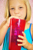 Consumición de la muchacha Imagen de archivo