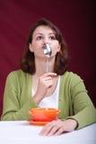 Consumición de la mujer 2 Imagen de archivo
