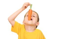 Consumición de la zanahoria Foto de archivo