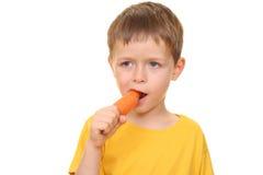 Consumición de la zanahoria Fotos de archivo