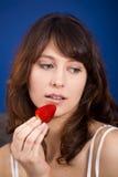 Consumición de las fresas Foto de archivo libre de regalías