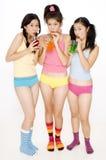 Consumición de las muchachas Imagenes de archivo