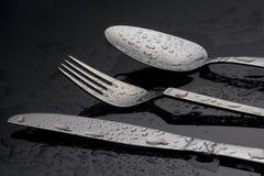 Consumición de los utensilios Imagen de archivo