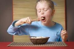 Consumición del arroz Fotografía de archivo libre de regalías