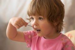 Consumición del desayuno Foto de archivo libre de regalías