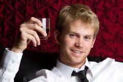 Consumición del hombre joven Foto de archivo libre de regalías