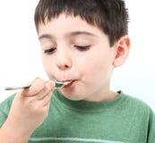 Consumición del muchacho Imagen de archivo