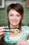 Consumición del sushi Foto de archivo