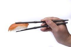 Consumición del sushi Imagen de archivo libre de regalías
