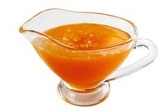 Consumición del utensilio con la miel Imagen de archivo