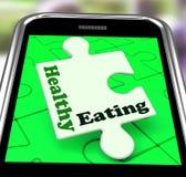 Consumición sana en las demostraciones de Smartphone Foto de archivo libre de regalías