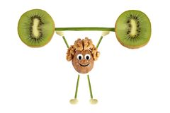 Consumición sana. La pequeña gente divertida de la nuez aumenta vagos del kiwi Imágenes de archivo libres de regalías