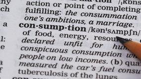 Consumption, pencil pointing word in dictionary, goods or energy usage, power. Stock footage stock video