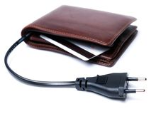 Consumption source. Conceptual view of a wallet with the cable and plug as a symbol of consumption Stock Photos