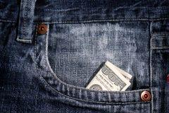conta de dólar 100 no bolso Fotografia de Stock Royalty Free