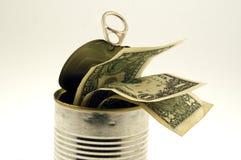 Conta de dólar na lata de estanho Imagens de Stock