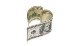 Conta de moeda do dólar na forma do coração Fotografia de Stock Royalty Free
