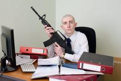 Contabilista armado com um rifle foto de stock royalty free
