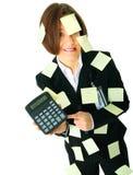Contable tensionado con número en la calculadora Foto de archivo libre de regalías