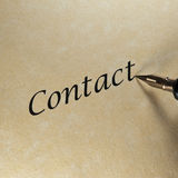 Contact. Concept of contact with a pen, texts and paper Stock Images