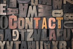 Contact. The word 'Contact' spelled out in very old letterpress blocks Royalty Free Stock Photo