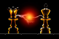 Contact. Queen and king on a black background. Art illumination Royalty Free Stock Image