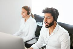 Contact Center Agent Consulting Customers Online Stock Photo