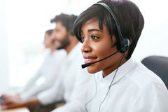 Contact Center Operator Consulting Client On Hotline. Attractive Afro-American Woman Serving Customers In Call-Center. High Resolution stock image