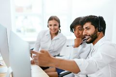 Contact Center Operators Consulting Customers Online. Multicultural Employees Working In Call-Center. High Resolution stock photography